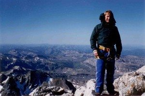 author Larry Kelley at the top of tetons